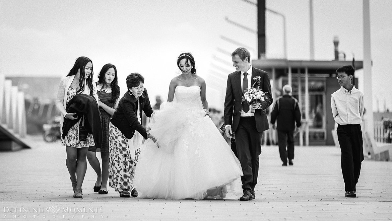 trouwfotograaf strandclub doen bruidsfotograaf scheveningen strand trouwreportage nieuwe_badkapel bruidsreportage den_haag journalistieke reportage documentaire bruidsfotografie